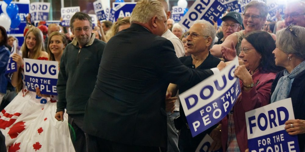 Doug Ford greets supporters during his election rally in Barrie