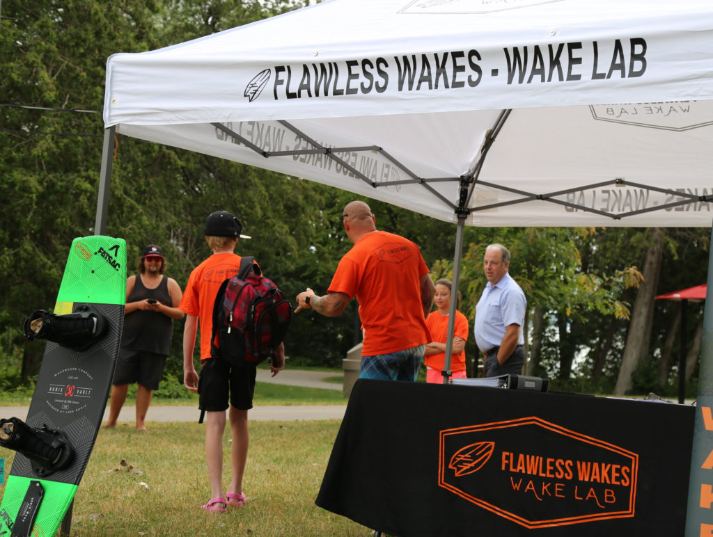 Flawless Wakes Owner Michael Therrien rounds the troops before prepping for kids camp.