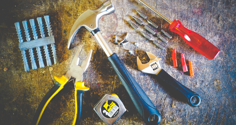 A pile of tools to signify illegal renovations found in a home inspection